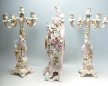 19TH CENTURY FRENCH REPRODUCTION THREE PIECE CLOCK AND CANDLESTICK SET.