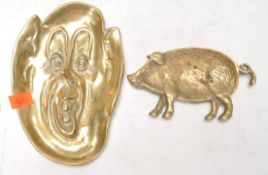 AN ANTIQUE BRASS DARTMOOR PIXIE TRAY TOGETHER WITH ANOTHER.