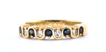 18KT GOLD DIAMOND AND BLUE STONE RING.