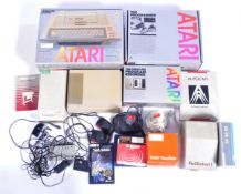 COLLECTION OF VINTAGE ATARI GAMING ALONG WITH A PLOT STATION 1