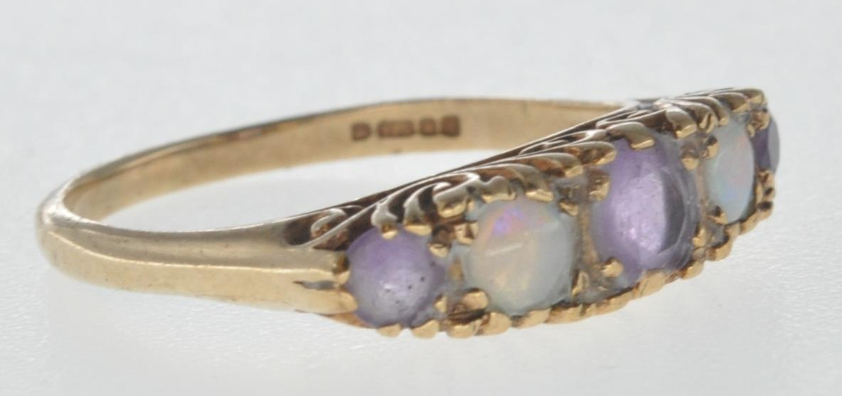 9CT GOLD RING SET WITH OPAL CABOCHONS AND PURPLE STONES. - Image 2 of 8