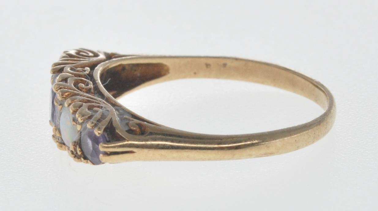 9CT GOLD RING SET WITH OPAL CABOCHONS AND PURPLE STONES. - Image 6 of 8