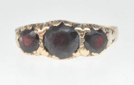 9CT GOLD AND THREE RED STONE RING