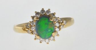 18CT GOLD BLACK OPAL AND DIAMOND RING