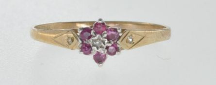 9CT GOLD RING SET WITH DIAMOND AND RED STONES.