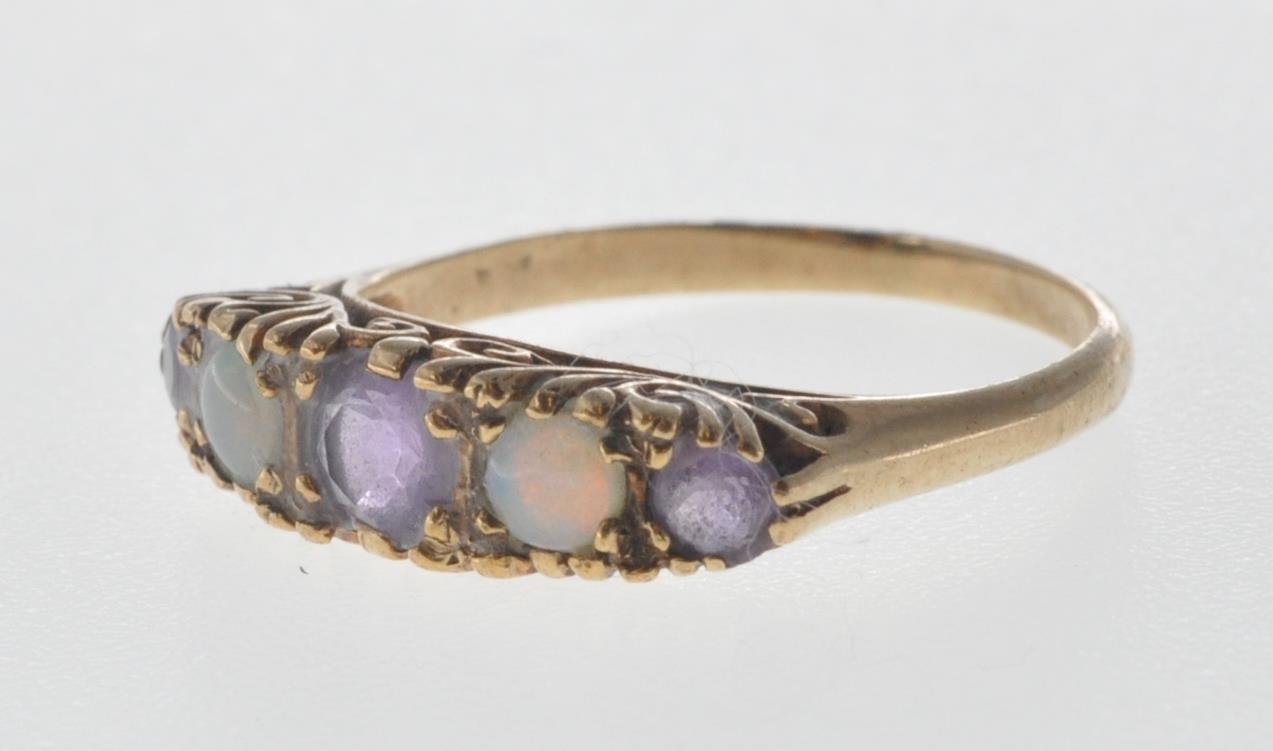 9CT GOLD RING SET WITH OPAL CABOCHONS AND PURPLE STONES. - Image 7 of 8