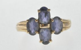 HALLMARKED 9CT GOLD AND PURPLE STONE RING.