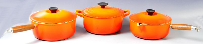 LE CREUSET - SELECTION OF THREE CAST IRON KITCHEN WARES