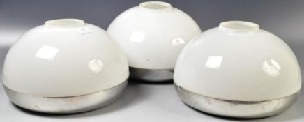 MANNER OF GUZZINI - SET OF THREE OPALINE GLASS AND CHROME SHADES.
