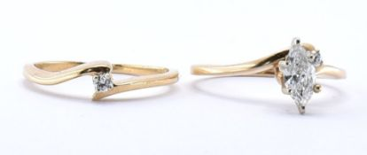 TWO 14CT GOLD CROSSOVER RINGS