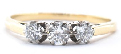 18CT GOLD AND DIAMOND THREE STONE RING