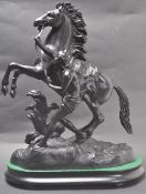 20TH CENTURY VINTAGE SPELTER FIGURINE OF A YOUTH CONTROLLING A REARING HORSE