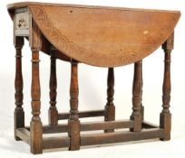 EARLY 20TH CENTURY OAK CARVED DROP LEAF DINING TABLE