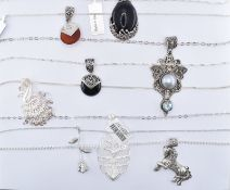 COLLECTION OF SILVER PENDANT NECKLACES