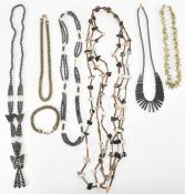 COLLECTION OF HEMATITE AND SHELL JEWELERY