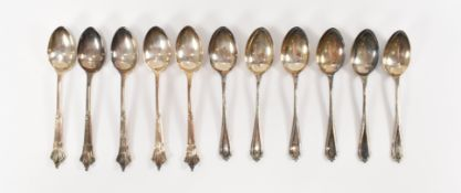TWO SETS OF SILVER TEASPOONS