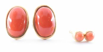 TWO PAIRS OF GOLD CORAL & RED GLASS STUD EARRINGS