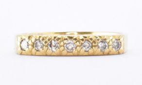18CT GOLD & DIAMOND SEVEN STONE RING