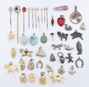 ASSORTMENT OF VINTAGE STICK PINS & CHARMS