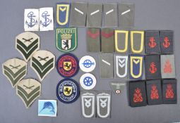 LARGE COLLECTION OF ASSORTED BRITISH NAVY UNIFORM CLOTH PATCHES