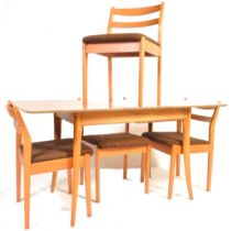 MID 20TH CENTURY TEAK DINING TABLE AND CHAIRS BY SCHREIBER