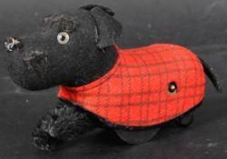 VINTAGE 1950S GERMAN SCHUCO CLOCKWORK TINPLATE SCOTTIE DOG TOY