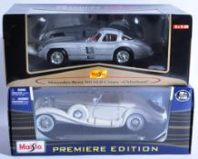 TWO MAISTO 1/18 SCALE PREMIER EDITION DIECAST MODEL CARS