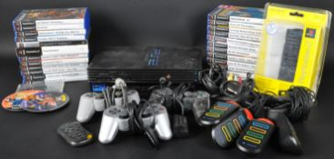 ORIGINAL PLAYSTATION 2 PS2 VIDEO GAMES CONSOLE, CONTROLLERS, LEADS AND LARGE COLLECTION OF GAMES
