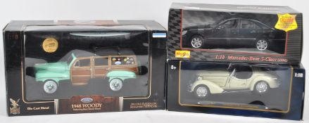 COLLECTION OF ASSORTED 1/18 SCALE BOXED DIECAST MODEL CARS