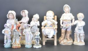 LARGE GROUP OF CONTINENTAL BISQUE CERAMIC FIGURINES