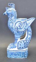 20TH CENTURY CHINESE REPUBLIC BLUE AND WHITE CERAMIC BIRD