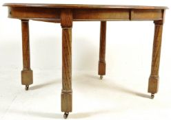 1920S SOLID OAK OVAL EXTENDING DINING TABLE