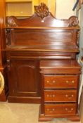 A reproduction mahogany chiffonier with solid shelved back above a pair of panelled doors, 121cm