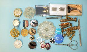 An RAF cap badge, two wrist watches, various badges, seals, cufflinks, etc.