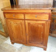 A rosewood and walnut floor-standing linen press with two drawers above four slides, enclosed by