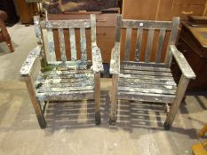 A pair of teak garden chairs with slatted backs and seats, both 59cm wide, (2).