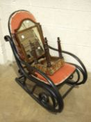 A stained bent wood rocking chair with padded seat and back, a shield-shaped dressing glass, 57cm