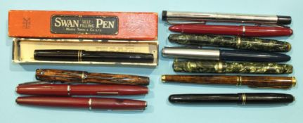 A Mabie Todd & Co Swan fountain pen, boxed, a Parker brown marble-effect fountain pen and nine