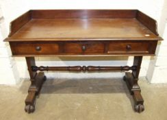 A Victorian mahogany washstand fitted with three small drawers on end supports joined by a pole