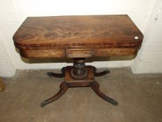 A George IV mahogany fold-over card table on turned and carved column and four hipped sabre legs,