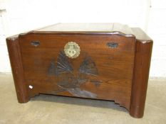 "An Oriental hardwood camphor-wood-lined blanket box with carved ""junks"" decoration on front, 102cm"