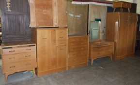 A suite of oak finish G-Plan bedroom furniture, including: wardrobe, tallboy, chest of five drawers,