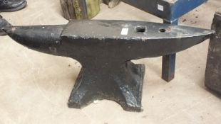 A large iron anvil, 81cm wide, 30cm high, an iron pump and a vintage mechanical hoe, (3).