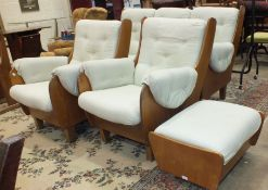 A 1970's G-Plan 'Saddle' three-piece hardwood and upholstered suite, short legs added to, with