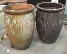 Two glazed pottery planters of slightly baluster ribbed form, 62cm high.