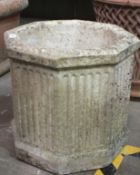Three chimney pots, 90cm high, (damages) and an octagonal reconstituted stone planter, 42cm high,