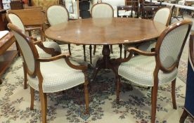 A suite of high-quality reproduction burr walnut dining furniture, comprising a circular cross and