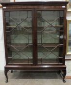 A mahogany bookcase with dentil cornice above two astragal-glazed doors, on later stand, 110cm wide,
