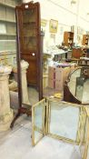 A 20th century mahogany cheval mirror, 161cm high and a painted wood triptych mirror, 54cm high.