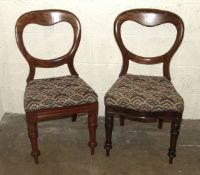 Eleven similar Victorian mahogany balloon-back dining chairs, all with drop-in seats and turned